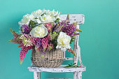 Basket with flowers peonies and lupins