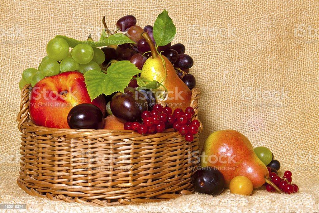Basket with fresh fruits royalty-free stock photo