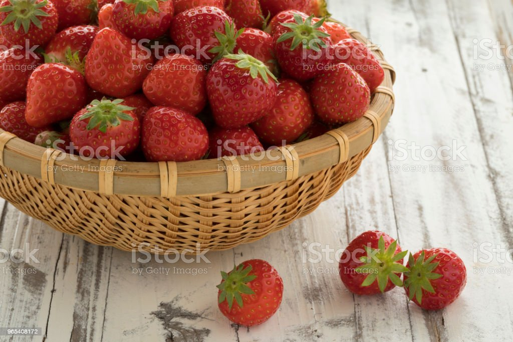 Basket with fresh ripe red strawberries royalty-free stock photo