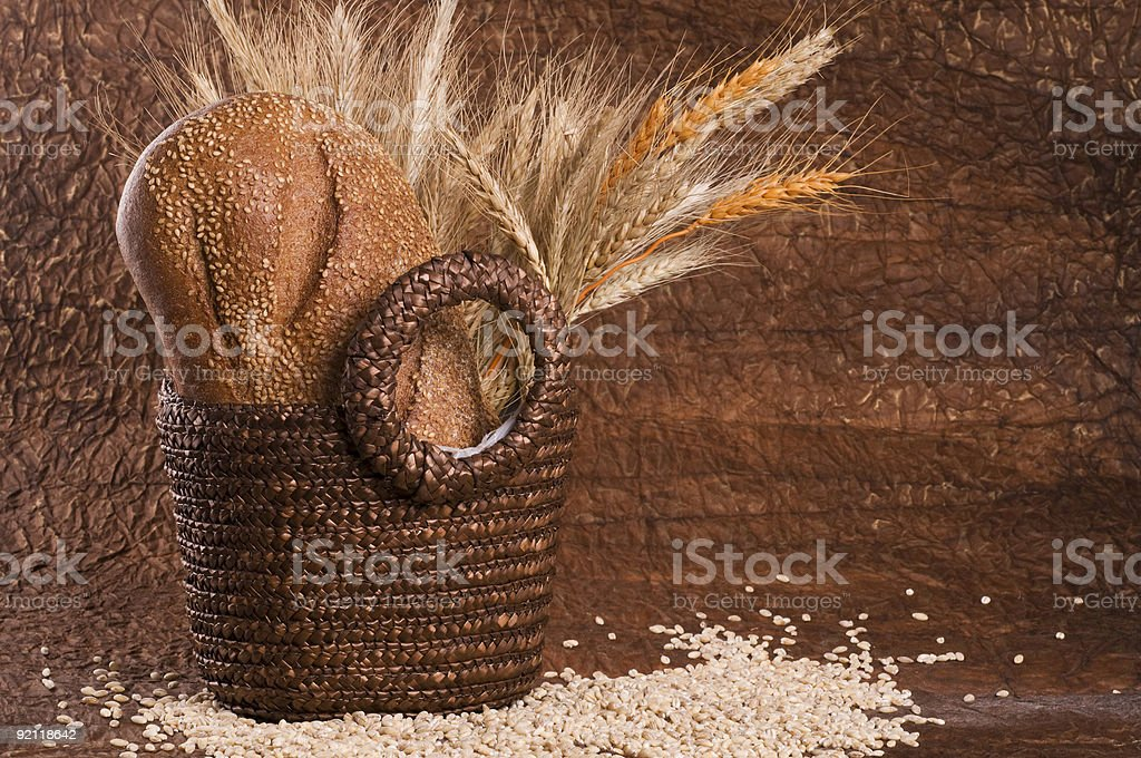 Basket with grain bread and cereals. royalty-free stock photo