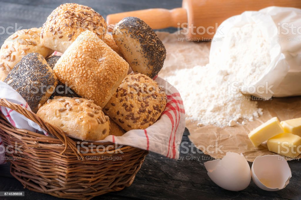 Basket with mixed buns and ingredients stock photo