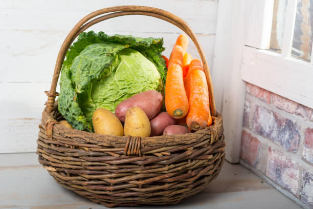 basket with raw vegetables for cooking a french Pot-au-feu basket with raw vegetables for cooking a french Pot-au-feu pot au feu stock pictures, royalty-free photos & images
