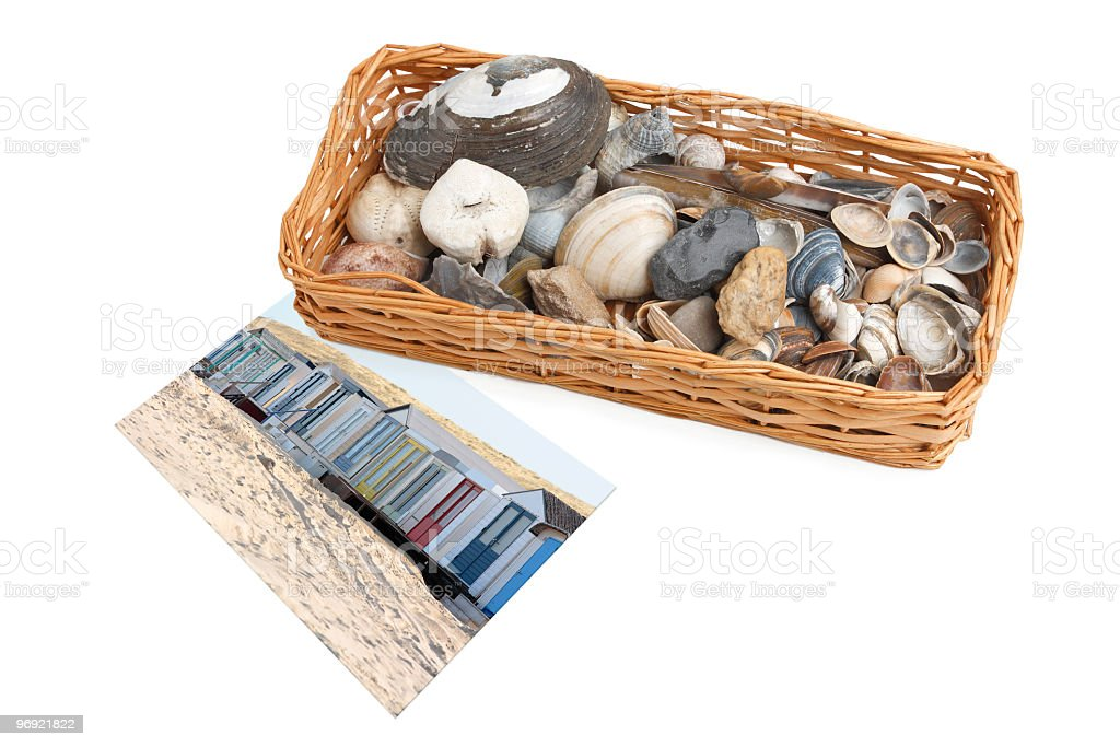 basket with seashells and pebbles next to the beach photo royalty-free stock photo