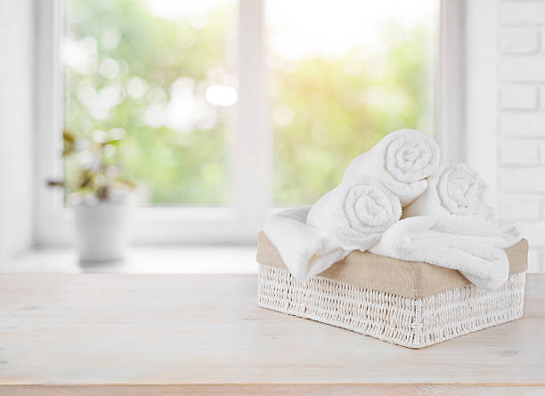 basket with towels on window sill over summer day background - pilha arranjo - fotografias e filmes do acervo