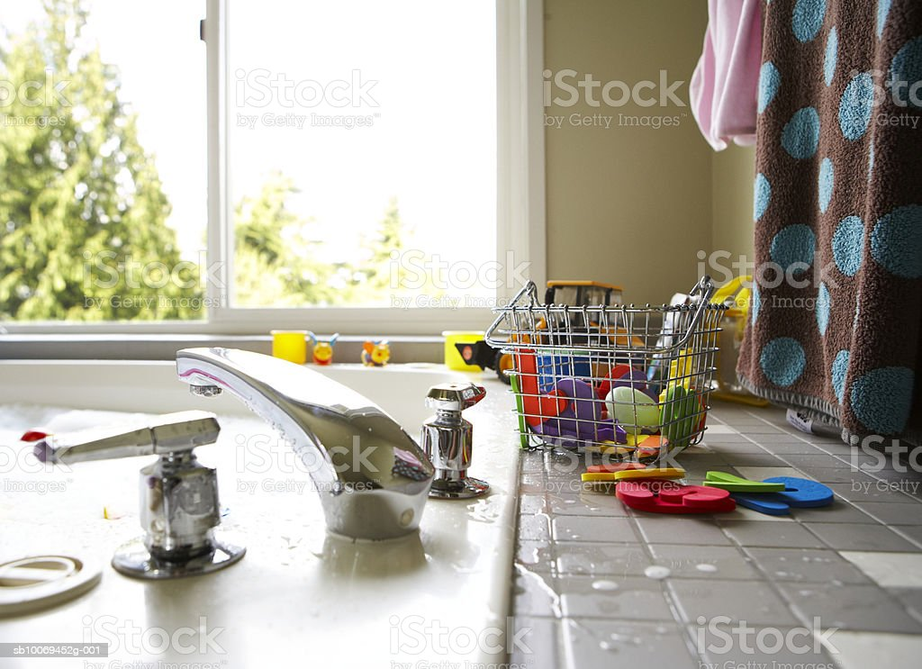 Basket with toys on kitchen worktop royalty-free stock photo
