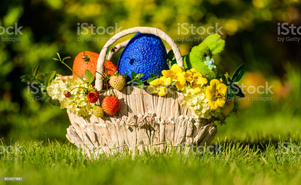 Basket With Traditional Easter Symbols Colored Eggs Bunny Flowers