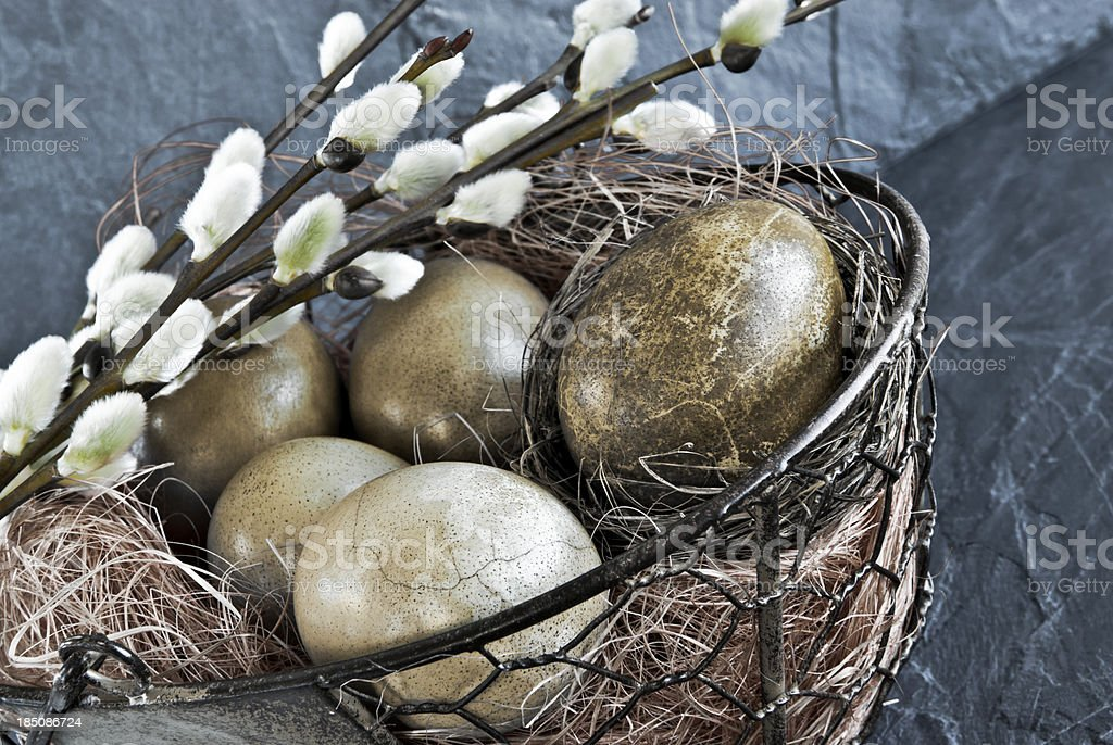 Basket with willow branches and eggs royalty-free stock photo