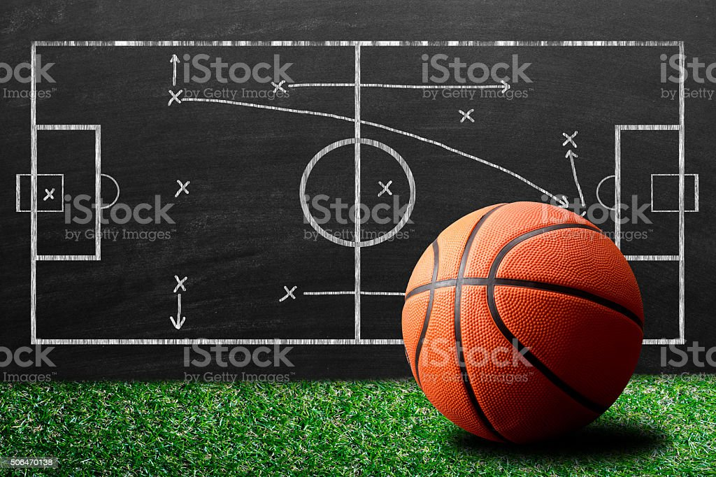 Basketball against game plan stock photo