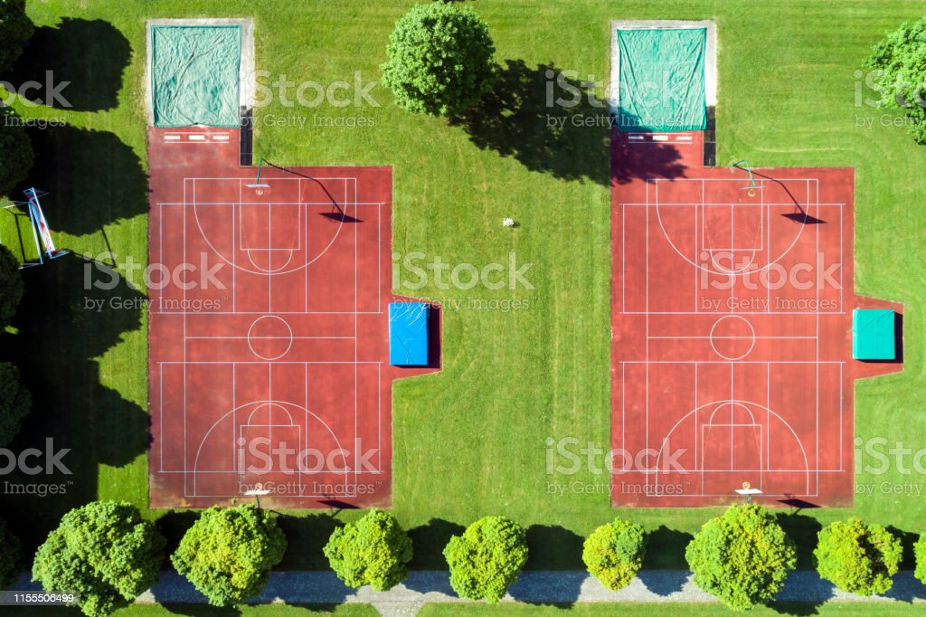 Aerial view of school sports ground with basketball, handball fields,...