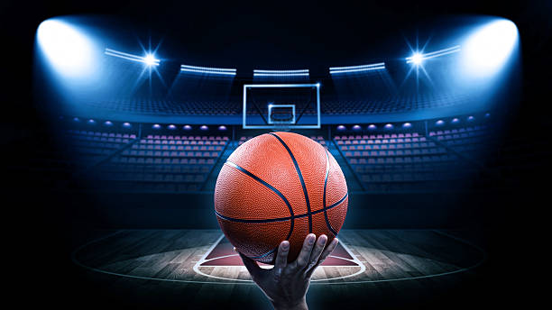 Basketball arena with player stock photo