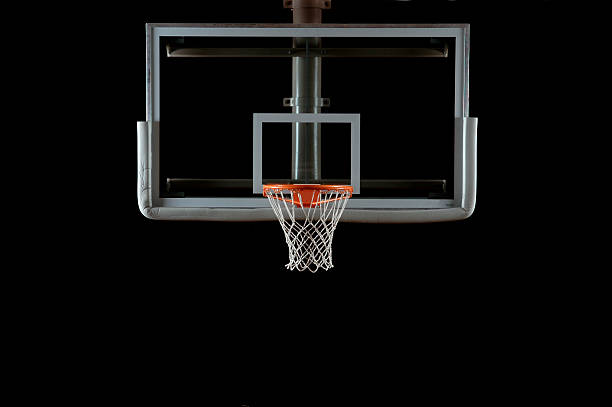Basketball Backboard and Hoop A glass basketball backboard and hoop isolated on black; lighting from the left and right sides.Here is a good link to some other basket stock pictures, royalty-free photos & images