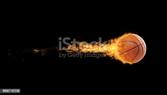 Basketball ball in flames over black background. Horizontal composition with copy space.