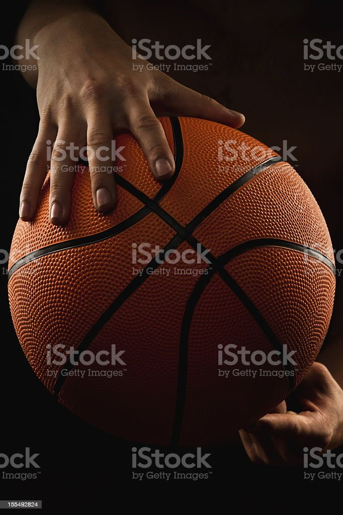 Basketball ball in male hands royalty-free stock photo