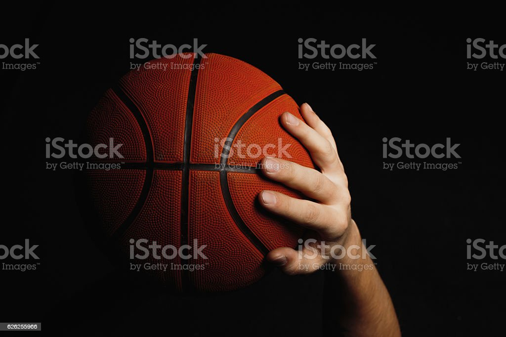 Basketball ball in male hands stock photo
