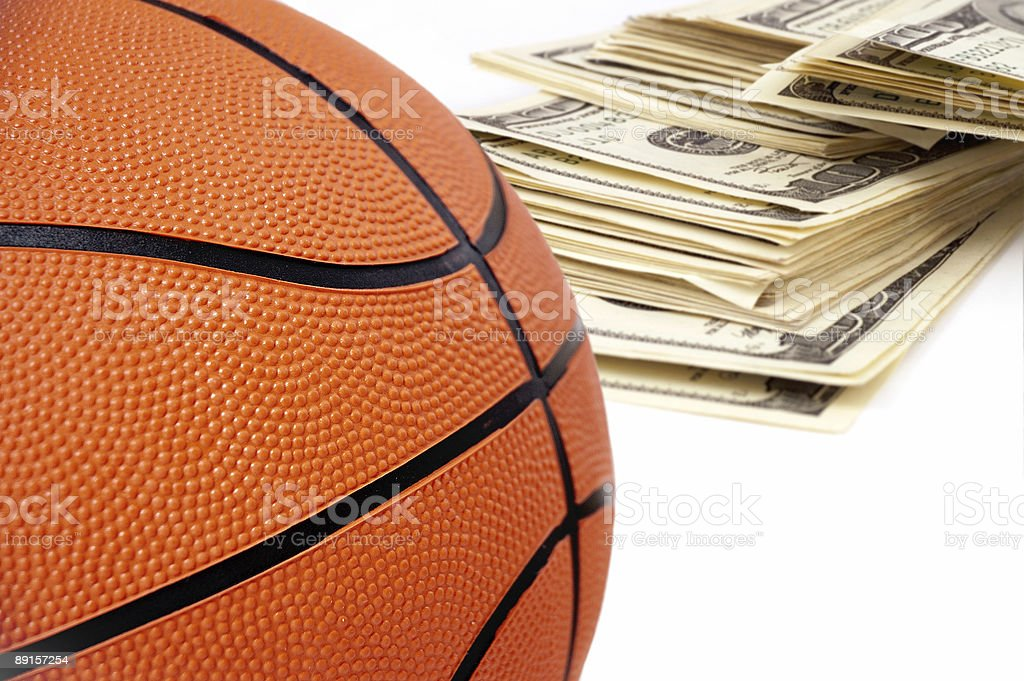 basketball ball on background of dollars. stock photo