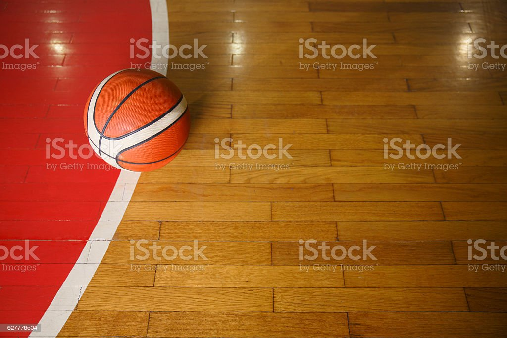 Basketball ball on court floor, parquet. Basketball background with...