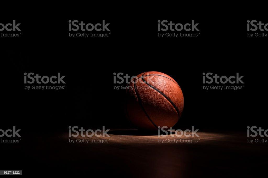Basketball ball spotlight stock photo