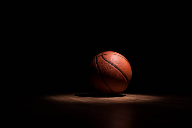 basketball ball spotlight - basketball stock pictures, royalty-free photos & images