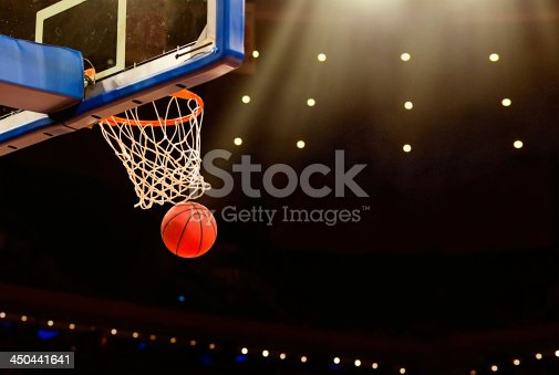 istock Basketball basket with ball going through net 450441641