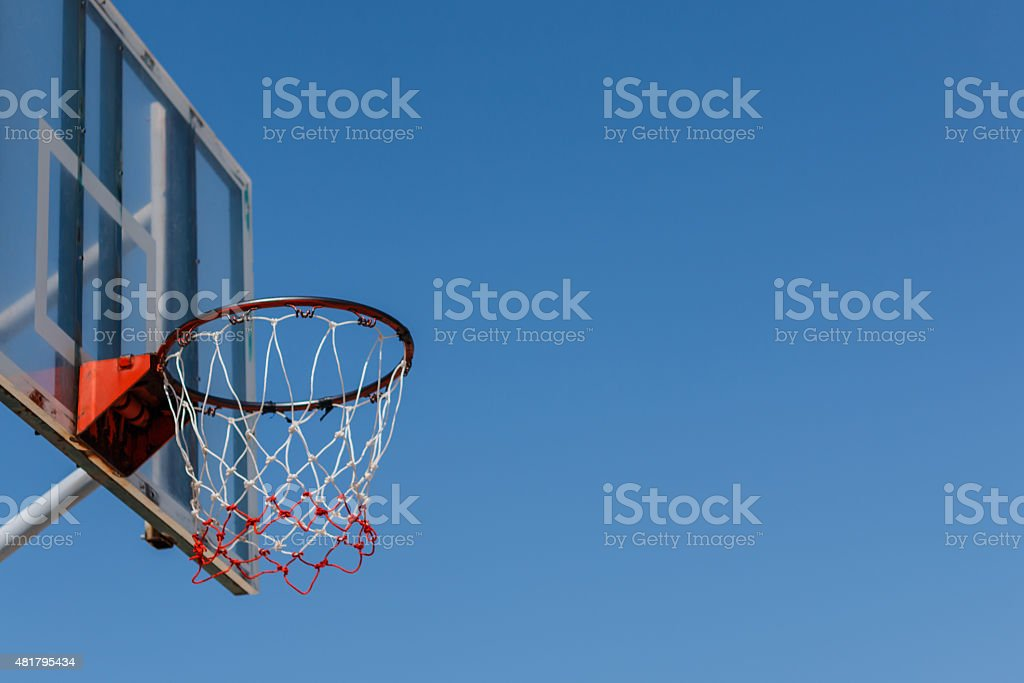 Basketball board and hoop with blue sky. stock photo