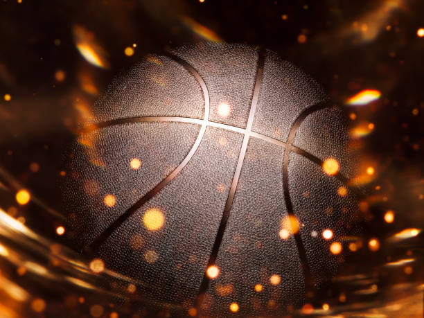 Basketball close-up on studio background - Stock image Basketball close-up on black background with bokeh, spotlights and fire basketball ball stock pictures, royalty-free photos & images