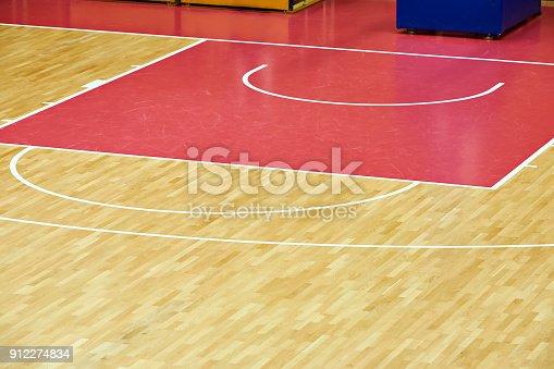 518943593istockphoto Basketball court parquet 912274834