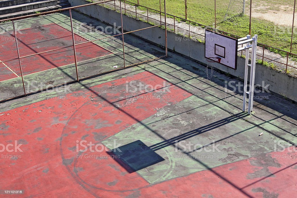 Basketball court that needs repair stock photo