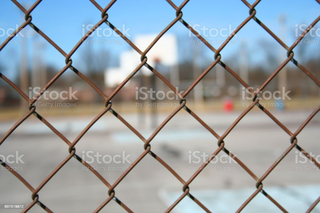 Basketball Court Through Fence stock photo