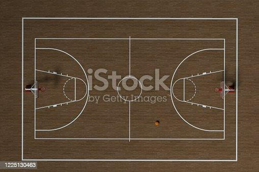 518943593 istock photo Basketball court with wooden floor, 3d rendering. 1225130463