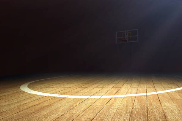 Basketball court with wooden floor and a basketball hoop Basketball court with wooden floor and a basketball hoop over dark background basketball ball stock pictures, royalty-free photos & images