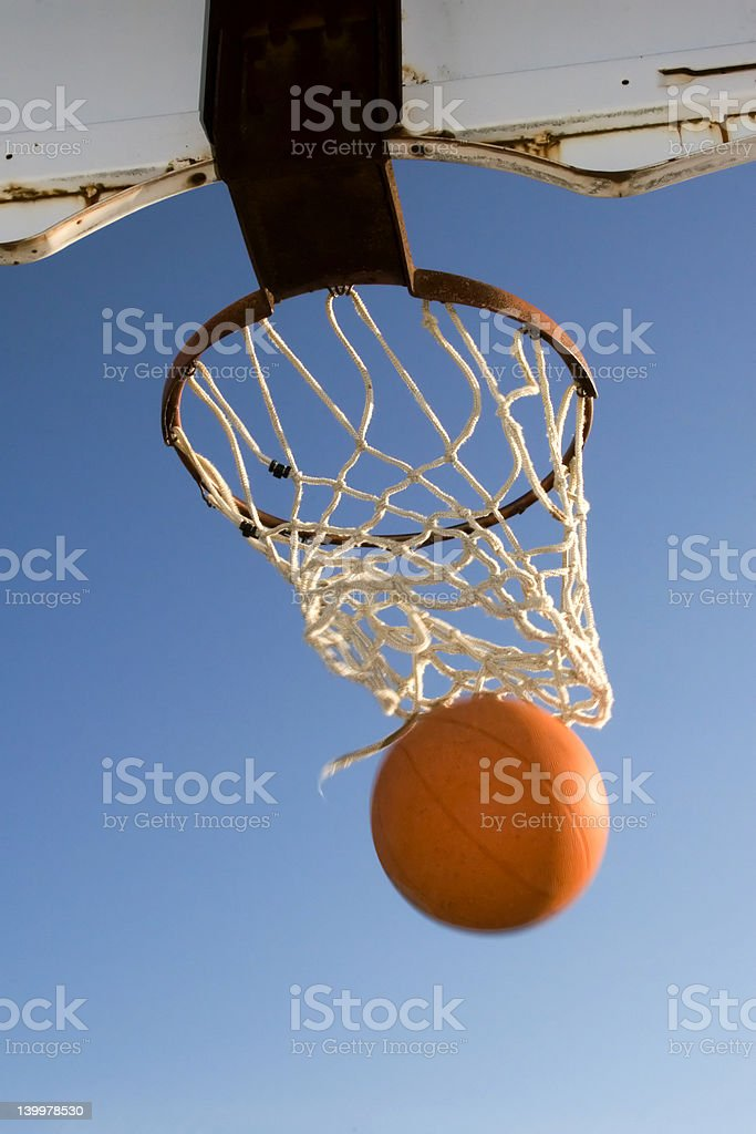 Basketball Emerging From Net royalty-free stock photo