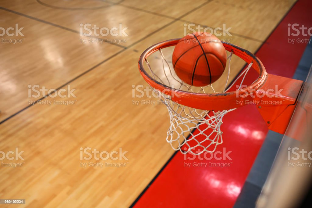 Basketball entering the hoop Overhead view of a Basketball Hoop Ball...