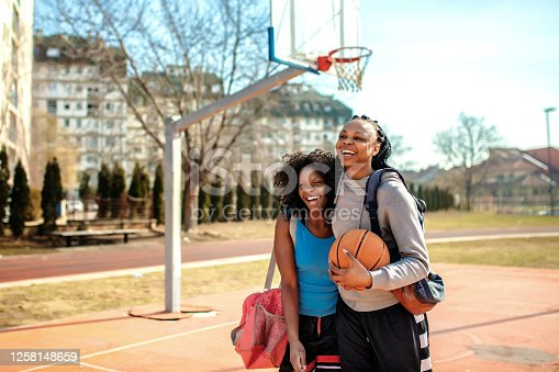 Street female basketball players playing basketball on the court