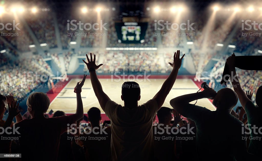 Basketball fans at basketball arena stock photo