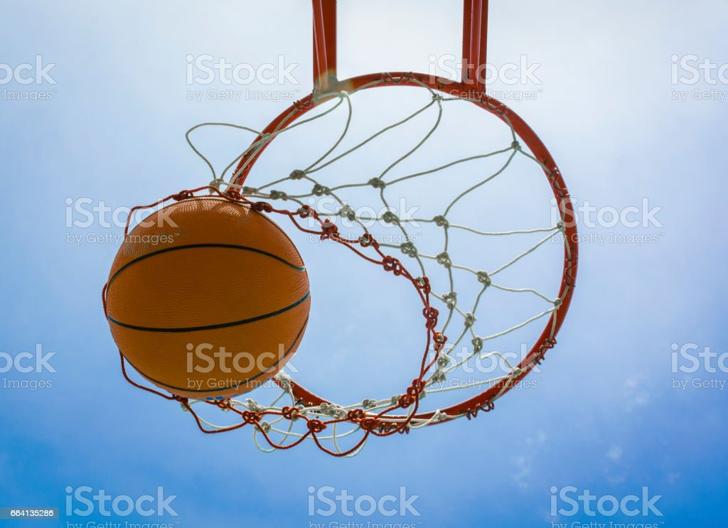 basketball field goal with the sky in background stock photo