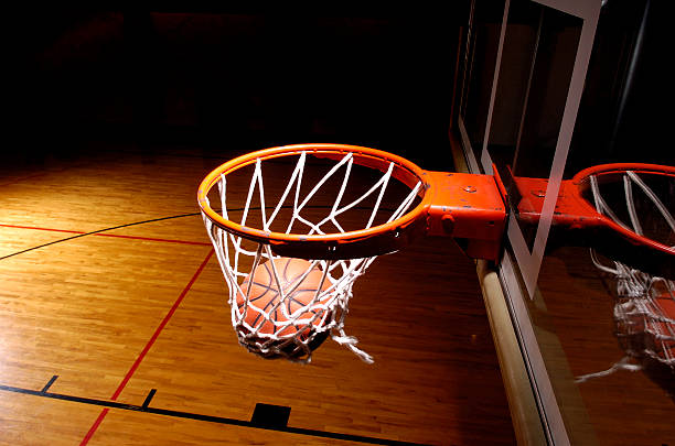 basketball goal with ball - basketball hoop stock pictures, royalty-free photos & images
