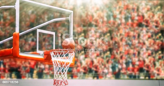 517960203 istock photo Basketball going through net and scoring during match ,Blurry and soft focus 665718256