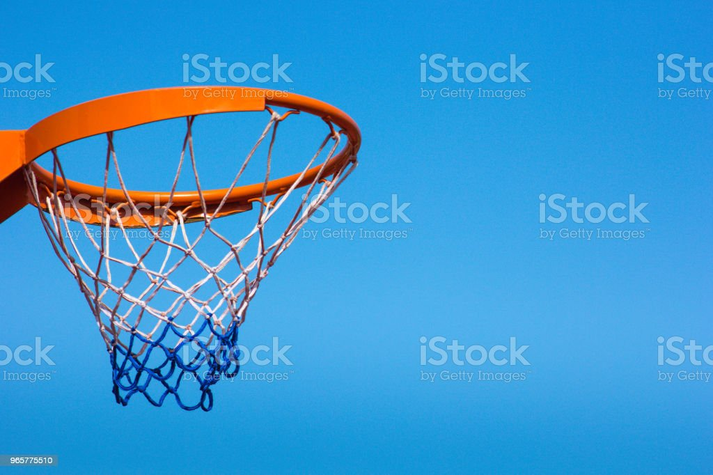 Basketball hoop against the blue sky, close-up - Royalty-free Activity Stock Photo