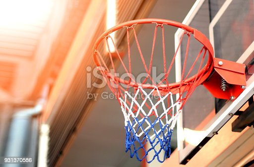 istock basketball hoop in gym under metal sheet roof 931370586