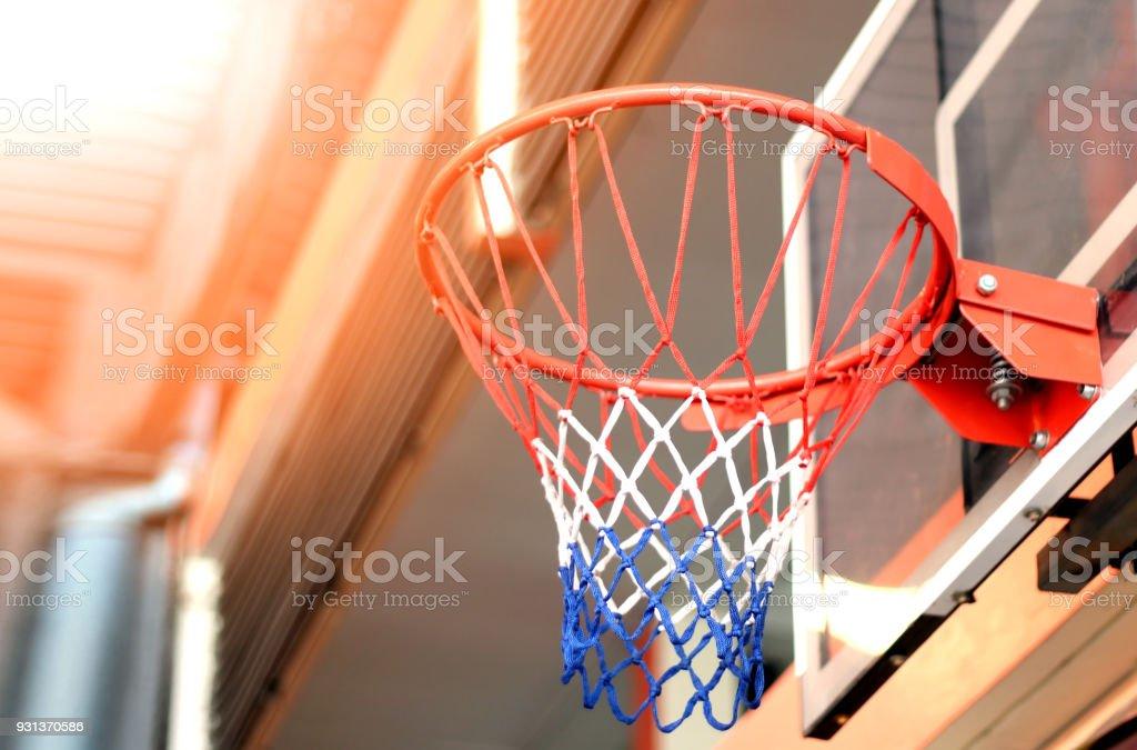 basketball hoop in gym under metal sheet roof stock photo