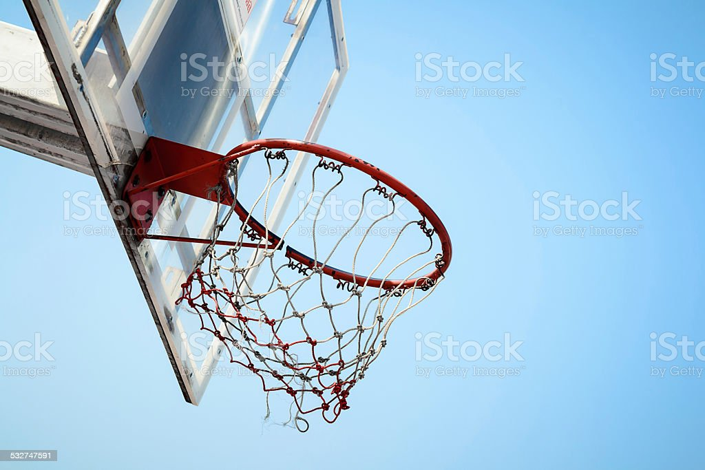 Basketball hoop in the blue sky stock photo