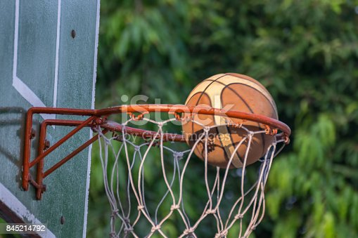 istock Basketball hoop make by wooden and ball in park 845214792