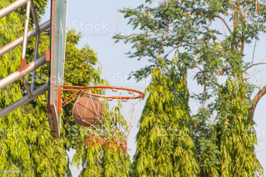 Basketball hoop make by wooden and ball in park