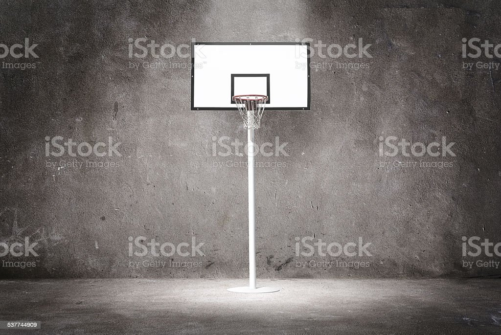 Basketball hoop on a textured wall stock photo