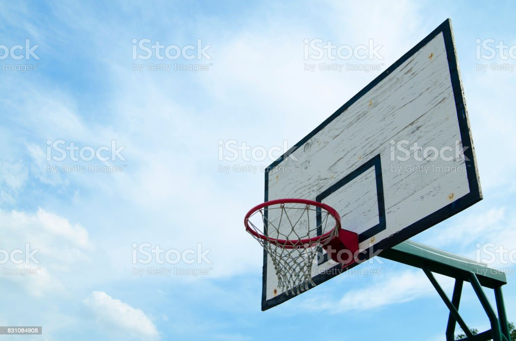 basketball hoop on board against blue sky outdoor in courtyard. Horizontal photography with copy paste for text. stock photo