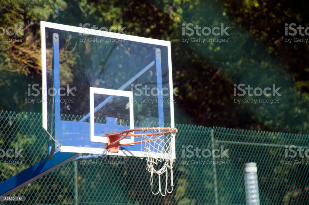 Basketball hoop outdoors in the sunlight. stock photo