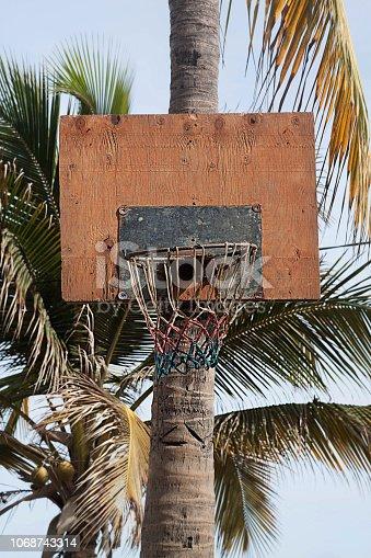Basketball hoop outdoors at the beach