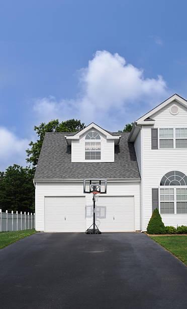 Basketball Hoop Suburban Home Driveway stock photo