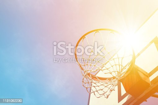 Basketball hoop under sunlight.