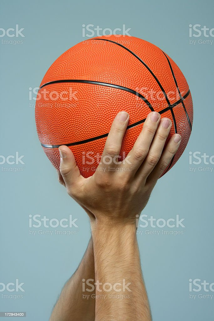 Basketball in hands stock photo